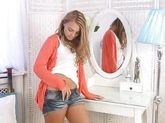 Stripteasing Teen Rubs Her Pussy